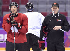 Photo - Team Canada captain Sidney Crosby, left, and head coach Mike Babcock, right, watch a drill during a practice session at the 2014 Sochi Winter Olympics in Sochi, Russia,  on Monday, Feb. 10, 2014. (AP Photo/The Canadian Press, Nathan Denette)