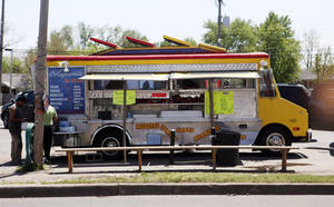 Photo - A food truck sells tacos to passers-by on SW 29 on Tuesday . <strong>KT King -  The Oklahoman </strong>