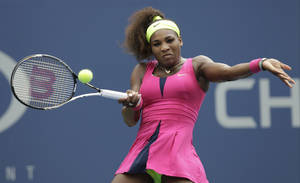Photo -   Serena Williams returns a shot to Czech Republic's Andrea Hlavackova in the fourth round of play at the 2012 US Open tennis tournament, Monday, Sept. 3, 2012, in New York. (AP Photo/Kathy Willens)