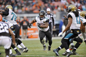 Photo - Jacksonville Jaguars running back Maurice Jones-Drew runs against the Cleveland Browns in the fourth quarter of an NFL football game on Sunday, Dec. 1, 2013, in Cleveland. (AP Photo/David Richard)