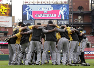 Photo - Pittsburgh Pirates players huddle together during a workout at Busch Stadium, Wednesday, Oct. 2, 2013, in St. Louis. Game 1 of the National League Division Series baseball playoff between the Pirates and the St. Louis Cardinals is scheduled for Thursday. (AP Photo/Charlie Riedel)
