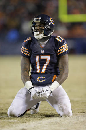 Photo - Chicago Bears wide receiver Alshon Jeffery (17) kneels after missing a reception during the second half of an NFL football game against the Green Bay Packers, Sunday, Dec. 29, 2013, in Chicago. (AP Photo/Nam Y. Huh)