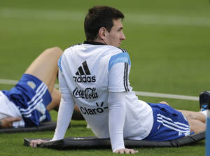 Photo - Argentina's Lionel Messi sits during a training session in Vespesiano, near Belo Horizonte, Brazil, Thursday, July 10, 2014. On Sunday, Argentina faces Germany for the World Cup final soccer match in Rio de Janeiro. (AP Photo/Victor R. Caivano)
