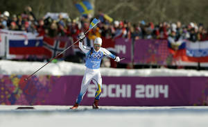 Photo - Sweden's Marcus Hellner celebrates winning the gold in the men's 4x10K cross-country relay at the 2014 Winter Olympics, Sunday, Feb. 16, 2014, in Krasnaya Polyana, Russia. (AP Photo/Felipe Dana)