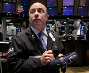 Photo -   In an April 6, 2012 photo trader Christopher Morie works on the floor of the New York Stock Exchange. Wall Street was poised for further modest gains Wednesday May 2, 2011, a day after the Dow Jones industrial average closed at its highest mark since 2007. (AP Photo/Richard Drew)