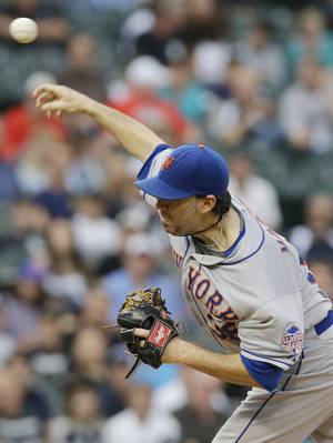 Photo - New York Mets starter Shaun Marcum throws against the Chicago White Sox during the third inning of an interleague baseball game Wednesday, June 26, 2013, in Chicago. (AP Photo/Nam Y. Huh)