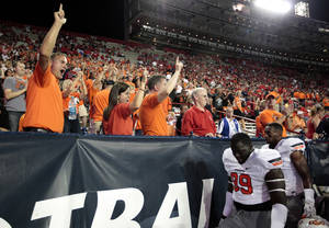 Photo - Fans cheer on Oklahoma State before the college football game between the University  of Arizona and Oklahoma State University at Arizona Stadium in Tucson, Ariz.,  Thursday, Jan. 17, 2008. Photo by Sarah Phipps, The Oklahoman