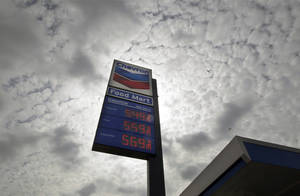 "photo -   FILE - In this Tuesday, Oct. 9, 2012, file photo, a Chevron station posts gasoline prices starting at $5.50 per gallon in downtown Los Angeles. Shares of Chevron Corp. plunged Wednesday after the oil giant said its third-quarter earnings are expected to be ""substantially lower"" than in the second quarter. (AP Photo/Reed Saxon, File)"