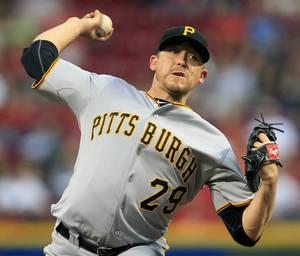 photo -   Pittsburgh Pirates starting pitcher Kevin Correia throws against the Cincinnati Reds in the second inning of a baseball game, Tuesday, Sept. 11, 2012, in Cincinnati. (AP Photo/Al Behrman)