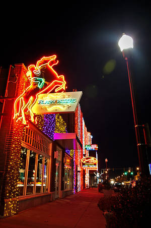 Photo - Automobile Alley on Broadway in downtown Oklahoma City is lit up for Christmas.