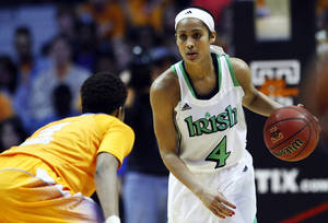 photo - Notre Dame guard Skylar Diggins (4) brings the ball upcourt as she's defended by Tennessee guard Kamiko Williams (4) in the second half of an NCAA college basketball game on Monday, Jan. 28, 2013, in Knoxville, Tenn. Notre Dame won 77-67. (AP Photo/Wade Payne)
