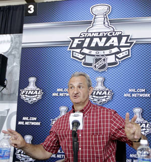 photo -   Los Angeles Kings head coach Darryl Sutter talks to the press during NHL hockey Stanley Cup Final media day, Tuesday, May 29, 2012, in Newark, N.J. (AP Photo/Julio Cortez)  
