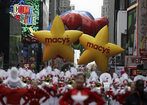Photo - The Spiderman balloon makes its way down Seventh Avenue during the Macy's Thanksgiving Day Parade in 2009. AP PHOTO <strong>Julie Jacobson - AP</strong>