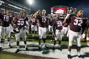 Photo -   Mississippi State quarterback Tyler Russell (17) joins his teammates in singing the school song following their 45-3 win over Middle Tennessee in an NCAA college football game in Starkville, Miss., Saturday, Oct. 20, 2012. (AP Photo/Rogelio V. Solis)