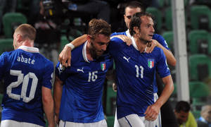 Photo - Italy's Alberto Gilardino, right, celebrates with teammate Daniele De Rossi, center, and Ignazio Abate, left, after scoring during the 2014 World Cup Group B qualifying soccer match between Italy and Bulgaria in Palermo, Italy, Friday Sept. 6, 2013. (AP Photo/Alessandro Fucarini)