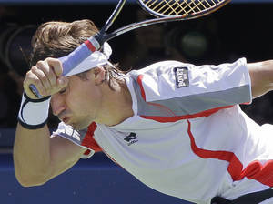 Photo -   Spain's David Ferrer returns a shot to Serbia's Novak Djokovic during a semifinal match at the 2012 US Open tennis tournament, Sunday, Sept. 9, 2012, in New York. Ferrer lost the match. (AP Photo/Kathy Willens)