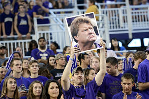 Photo - In this Aug. 31, 2013 photo, a fan holds up a picture of James Madison University's head coach Mickey Matthews during at NCAA college football game against Central Connecticut State in Harrisonburg, Va. Matthews has been fired after 15 seasons as head football coach at James Madison. Athletic Director Jeff Bourne announced the move Monday, Nov. 25, 2013. (AP Photo/The Daily News-Record, Jason Lenhart) NO SALES