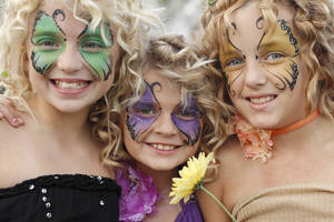 Sisters from left, Emily Blackburn, 10, Anna Blackburn, 9, and Raven Buchanan, 10, show off their face paint during the Fairy Ball in the Paseo Saturday, September 24, 2011. Photo by Doug Hoke, The Oklahoman. ORG XMIT: KOD <strong>Doug Hoke - THE OKLAHOMAN</strong>