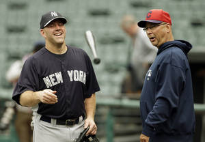 Photo - New York Yankees third baseman Kevin Youkilis, left, talks with Cleveland Indians manager Terry Francona before a baseball game Monday, April 8, 2013, in Cleveland. (AP Photo/Mark Duncan)