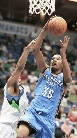 Photo - Thunder forward Kevin Durant, right, scored 30 points against Minnesota on Sunday. AP photo