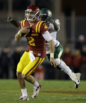 Photo -   Iowa State quarterback Steele Jantz runs from Baylor cornerback Ahmad Dixon, right, during the first half of an NCAA college football game, Saturday, Oct. 27, 2012, in Ames, Iowa. (AP Photo/Charlie Neibergall)