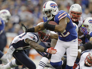 Photo -   Buffalo Bills' Fred Jackson (22) runs against the New England Patriots during the first half of an NFL football game in Orchard Park, N.Y., Sunday, Sept. 30, 2012. (AP Photo/Gary Wiepert)