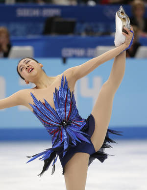 Photo - Mao Asada of Japan competes in the women's free skate figure skating finals at the Iceberg Skating Palace during the 2014 Winter Olympics, Thursday, Feb. 20, 2014, in Sochi, Russia. (AP Photo/Bernat Armangue)