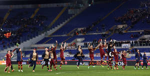 Photo - AS Roma players celebrate at the end of a Serie A soccer match between AS Roma and Sampdoria, at Rome's Olympic stadium, Sunday, Feb. 16, 2014. AS Roma won 3-0. (AP Photo/Riccardo De Luca)