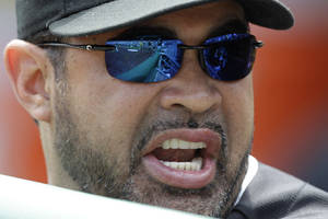 Photo -   Miami Marlins manager Ozzie Guillen stands in the dugout during the first inning of a baseball game against the Pittsburgh Pirates in Pittsburgh Sunday, July 22, 2012. The Pirates won 3-0. (AP Photo/Gene J. Puskar)