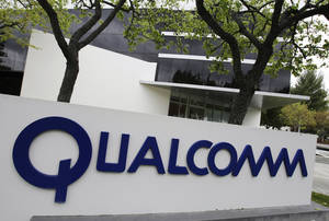 Photo - FILE - In this April 18, 2011 file  photo, the exterior of Qualcomm offices are shown in Santa Clara, Calif. Qualcomm said Friday, Dec. 13, 2013, that long-time executive Steve Mollenkopf will become its CEO in March. (AP Photo/Paul Sakuma, File)