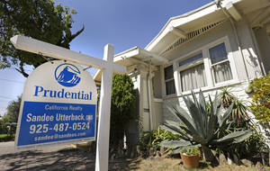 Photo - This Monday, July 14, 2014, photo shows a home for sale in Alameda, Calif. Average U.S. long-term mortgage rates were stable to slightly higher this week, remaining near their lows for the year. (AP Photo/Ben Margot)