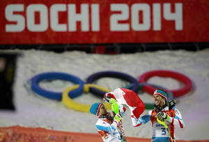 Photo - Men's slalom winners Austria's Mario Matt (gold), right, and his teammate Austria's Marcel Hirscher (silver) celebrate on the podium at the Sochi 2014 Winter Olympics, Saturday, Feb. 22, 2014, in Krasnaya Polyana, Russia  (AP Photo/Gero Breloer)