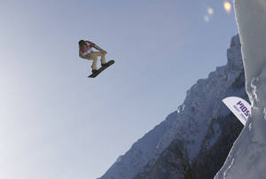 Photo - Shaun White of the United States takes a jump during a Snowboard Slopestyle training session at the Rosa Khutor Extreme Park, prior to the 2014 Winter Olympics, Tuesday, Feb. 4, 2014, in Krasnaya Polyana, Russia. (AP Photo/Andy Wong)