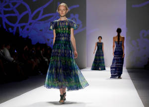 Photo -   The Tadashi Shoji Spring 2013 collection is modeled during Fashion Week in New York, Thursday, Sept. 6, 2012. (AP Photo/Richard Drew)