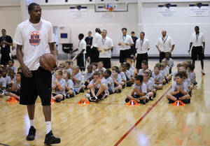 Photo - Kevin Durant gives a demonstration on his summer practice routine during the Kevin Durant basketball camp at Heritage Hall Wednesday, June 29, 2011.  Photo by Garett Fisbeck, The Oklahoman ORG XMIT: KOD