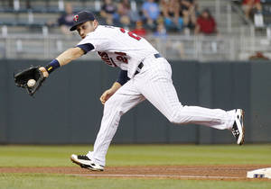 Photo - Minnesota Twins third baseman Trevor Plouffe makes a play against the Los Angeles Angels in the fourth inning of their baseball game in Minneapolis Monday, Sept. 9, 2013.(AP Photo/Andy Clayton-King)