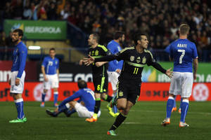 Photo - Spain's Pedro Rodriguez, centre, celebrates his goal during a international friendly soccer match between Spain and Italy at the Vicente Calderon stadium in Madrid, Spain, Wednesday, March 5, 2014. (AP Photo/Andres Kudacki)