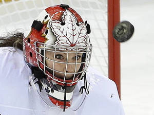 Photo - Goalkeeper Shannon Szabados of Canada looks for the rebound on a blocked shot against Switzerland during the first period of the 2014 Winter Olympics women's semifinal ice hockey game at Shayba Arena, Monday, Feb. 17, 2014, in Sochi, Russia. (AP Photo/Matt Slocum)