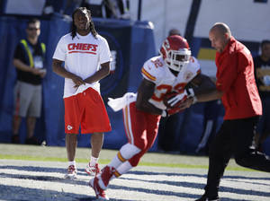 Photo - Kansas City Chiefs running back Jamaal Charles, left, looks on as teammate running back Cyrus Gray, second from right, warms up before playing the San Diego Chargers in an NFL football game Sunday, Dec. 29, 2013, in San Diego. (AP Photo/Lenny Ignelzi)