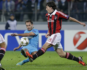 Photo -   Zenit's Roman Shirokov, left, fights for the ball with AC Milan's Riccardo Montolivo during the UEFA Champions League, group C, soccer match, between AC Milan and Zenit St. Petersburg in St.Petersburg, Russia, Wednesday, Oct. 3, 2012. (AP Photo/Dmitry Lovetsky)