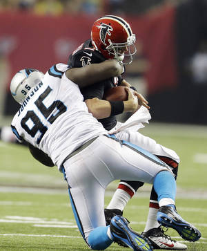 photo -   In this photo taken Sunday, Sept. 30, 2012, Carolina Panthers defensive end Charles Johnson (95) sacks Atlanta Falcons quarterback Matt Ryan (2) during the second half of an NFL football game in Atlanta. The Panthers may still be stinging from Sunday's heartbreaking loss to Atlanta, but there are still plenty of positives to come out of that game including the steady emergence of a pass rush. The Panthers tied a franchise record with seven sacks _ 3.5 by Charles Johnson _ something they hope to continue this Sunday at home against Seattle. (AP Photo/David Goldman)