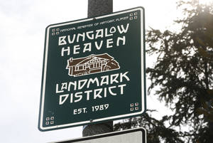 "Photo - This Feb 12, 2014 photo shows a sign marking the ""Bungalow Heaven"" district in Pasadena, Calif. Bungalow Heaven is a 16 block neighborhood, designated Pasadena's very first preserved historic landmark district in 1989, consisting of more than 1,000 bungalow homes from the early 20th century. (AP Photo/Nick Ut)"