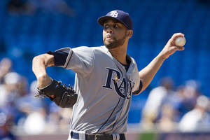 Photo -   Tampa Bay Rays starting pitcher David Price works against Toronto Blue Jays during the second inning of baseball game action in Toronto, Sunday, Sept. 2 , 2012. (AP Photo/The Canadian Press, Chris Young)