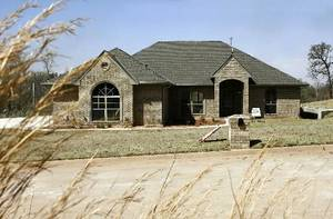 Photo - Gemini Builders built this home, to be open during the East Area Festival of Homes, at 15023 Scottsdale Lane in Choctaw.