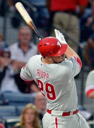Photo - Philadelphia Phillies' Cameron Rupp hits a two run single that scores against the Atlanta Braves during the first inning of a baseball game at Turner Field, Saturday, Sept. 28, 2013, in Atlanta. (AP Photo/David Tulis)