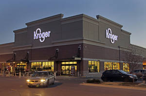 photo - FILE - This June 12, 2012 file photo shows a Kroger store in Indianapolis. The Kroger Co. announced Thursday, March 7, 2013 that its fourth-quarter profit in 2012 handily beat Wall Street expectations. (AP Photo/Michael Conroy, File)