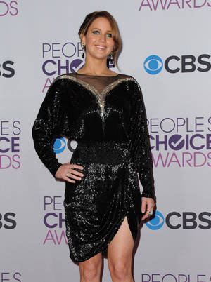 Photo - Jennifer Lawrence, winner of the award for favorite movie actress, poses backstage at the People's Choice Awards at the Nokia Theatre on Wednesday Jan. 9, 2013, in Los Angeles. (Photo by Jordan Strauss/Invision/AP)