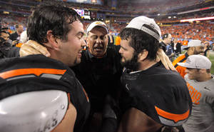 photo - COLLEGE FOOTBALL / CELEBRATION: Oklahoma State offensive coordinator Todd Monken celebrates with Oklahoma State's Nick Martinez (75), left, and Oklahoma State's Grant Garner (74) after the Fiesta Bowl between the Oklahoma State University Cowboys (OSU) and the Stanford Cardinals at the University of Phoenix Stadium in Glendale, Ariz., Tuesday, Jan. 3, 2012. Photo by Bryan Terry, The Oklahoman
