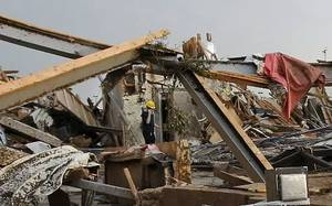 Photo - A person stands next to an open vault inside the Tinker Federal Credit Union in Moore after it was destroyed by a tornado on Monday, May 20, 2013. Photo by Jim Beckel,