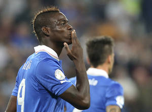 Photo - Italy forward Mario Balotelli celebrates after scoring to put his team ahead during the 2014 World Cup Group B qualifying soccer match between Italy and Czech Republic at the Juventus stadium in Turin, Italy, Tuesday, Sept. 10, 2013. (AP Photo/Antonio Calanni)